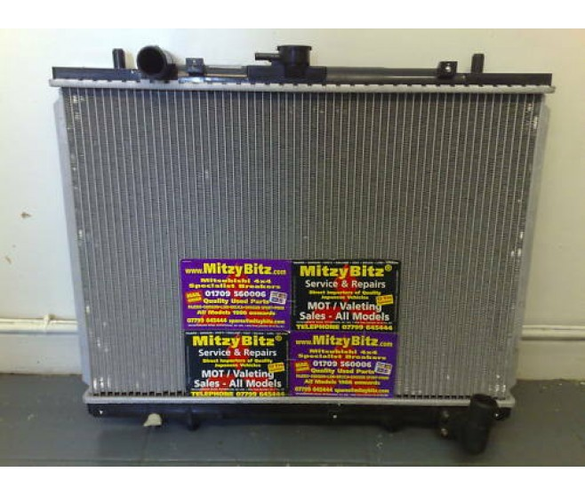 RADIATOR ( FITS UP TO JUNE 2001-TURBO ONLY ) FOR A MITSUBISHI STRADA - K74T